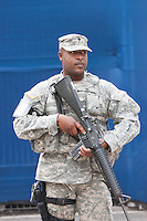 A marine armed with assault rifle at the World Trade Center PATH station.