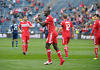 Chicago forward Dominic Oduro (8) shows his boot to the crowd after scoring Chicago's second goal.  The Chicago Fire defeated the New England Revolution 3-2 at Toyota Park in Bridgeview, IL on Sept. 25, 2011.