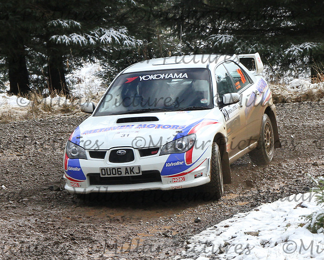 Martin Craik - Steven Brown in a Subaru Impreza at Junction 6 on Special Stage 1 Riccarton on the Brick & Steel Border Counties Rally 2014, Round 2 of the RAC MSA Scottish Rally Championship sponsored by ARR Craib Transport Limited and other championships  and organised by Whickham & District and Hawick & Border Car Clubs and based in Jedburgh and held in Kielder Forest on 22.3.14.