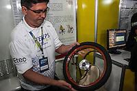 SÃO PAULO, SP, 21.10.2014 -  8ª FEIRA DE TECNOLOGIA DO CENTRO PAULA SOUZA (FETEPS) - O aluno Edilson Bonforno, da ETEC São Paulo, exibe um protótipo de cadeira de rodas estabilizadora, que permite ao cadeirante maior estabilidade ao usar escadas rolantes e rampas, na 8ª Feira de Tecnologia do Centro Paula Souza a Eco Bike, um protótipo de bicicleta construida a partir do bambú, na tarde desta terça-feira (21), em São Paulo. Ao todo são 244 projetos desenvolvidos por estudantes das ETECs e FATECs do estado de São Paulo, 15 projetos desenvolvidos por alunos de outros países e mais 5 de outros estados do Brasil. (Foto: Taba Benedicto/ Brazil Photo Press)