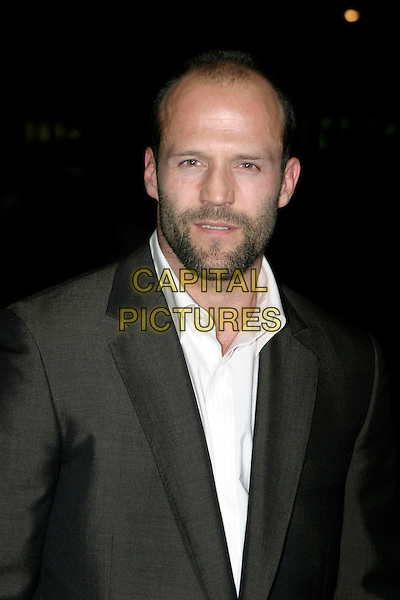 "JASON STATHAM.Arrivals at The ""Revolver"" world premiere held at The Odeon Cinema, Leicester Square,.London, 20th September 2005.portrait headshot grey gray shiney suit .Ref: AH.www.capitalpictures.com.sales@capitalpictures.com.© Capital Pictures."