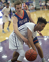 NWA Democrat-Gazette/ANDY SHUPE<br /> Jon Conley (center) of Fayetteville and Seth Stanley of Heritage vie for a loose ball Tuesday, Feb. 13, 2018, during the second half of play in Bulldog Arena in Fayetteville. Visit nwadg.com/photos to see more photographs from the games.