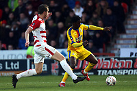 Jeffrey Schlupp of Crystal Palace and Tom Anderson of Doncaster Rovers during Doncaster Rovers vs Crystal Palace, Emirates FA Cup Football at the Keepmoat Stadium on 17th February 2019
