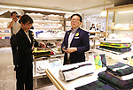 "July 27, 2018, Tokyo, Japan - Japanese Economy, Trade and Industry Minister Hiroshige Seko purchases a premium towel called Imabari towel as he attends a promotional event of the ""Premium Friday"" at the Isetan department store in Tokyo on Friday, July 27, 2018. The Premium Friday campaign promoted workers to leave office 3 p.m. in the afternoon of the last Friday of the month for the stimulation of consumption such as shopping.      (Photo by Yoshio Tsunoda/AFLO) LWX -ytd-"