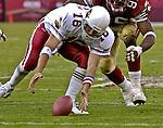 Arizona Cardinals quarterback Jake Plummer (16) recovers fumbled ball on Sunday, October 27, 2002, in San Francisco, California. The 49ers defeated the Cardinals 38-28.