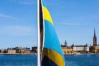 Sweden, Stockholm. Flag on passenger boat, Lake Mälaren.