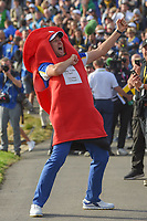 Ian Poulter (Team Europe) dons a costume provided by an avid fan following Sunday's singles of the 2018 Ryder Cup, Le Golf National, Guyancourt, France. 9/30/2018.<br /> Picture: Golffile | Ken Murray<br /> <br /> <br /> All photo usage must carry mandatory copyright credit (© Golffile | Ken Murray)