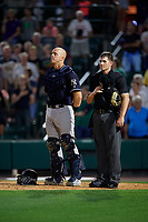 Scranton/Wilkes-Barre RailRiders catcher Erik Kratz (47) and umpire Richard Riley stand for God Bless America during the seventh inning stretch during an International League game against the Rochester Red Wings on June 24, 2019 at Frontier Field in Rochester, New York.  Rochester defeated Scranton 8-6.  (Mike Janes/Four Seam Images)