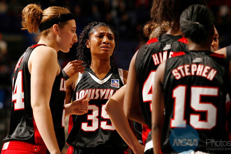 07 APR 2009:  Angel McCoughtry (35) of the University of Louisville shows her frustration during the closing minutes of the Cardinals loss to the University of Connecticut during the Division I Women's Basketball Championship held at the Scottrade Center in St. Louis, MO.  Connecticut defeated Louisville 76-54 for the national title.  Jamie Schwaberow/NCAA Photos