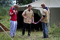 Swiss participants fixing their scarfs. Photo: Mikko Roininen / Scouterna