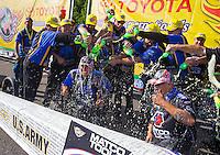 Jun 7, 2015; Englishtown, NJ, USA; NHRA top fuel driver Antron Brown celebrates in winners circle with his crew after winning the Summernationals at Old Bridge Township Raceway Park. Mandatory Credit: Mark J. Rebilas-