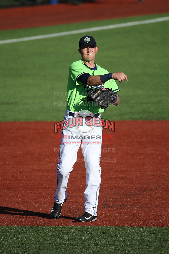 Drew Ellis (15) of the Hillsboro Hops throws to first base during a game against the Spokane Indians at Ron Tonkin Field on July 23, 2017 in Hillsboro, Oregon. Spokane defeated Hillsboro, 5-3. (Larry Goren/Four Seam Images)