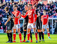 Barnsley's defender Angus MacDonald (5) and Leeds United's defender Liam Cooper (6) with their ribbon armbands during the Sky Bet Championship match between Barnsley and Leeds United at Oakwell, Barnsley, England on 25 November 2017. Photo by Stephen Buckley / PRiME Media Images.