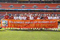 22 MAY 2010:  USA WNT and Germany WNT hold a banner for the 2011 Women's World Cup before the International Friendly soccer match between Germany WNT vs USA WNT at Cleveland Browns Stadium in Cleveland, Ohio. USA defeated Germany 4-0 on May 22, 2010.