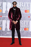 LONDON, UK. February 20, 2019: AJ Tracey arriving for the BRIT Awards 2019 at the O2 Arena, London.<br /> Picture: Steve Vas/Featureflash<br /> *** EDITORIAL USE ONLY ***