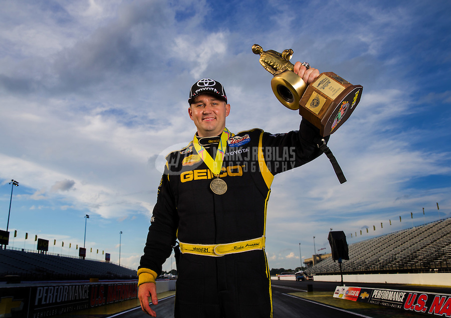 Sept. 1, 2014; Clermont, IN, USA; NHRA top fuel driver Richie Crampton poses for a portrait as he celebrates with the Wally trophy after winning the US Nationals at Lucas Oil Raceway. Mandatory Credit: Mark J. Rebilas-USA TODAY Sports