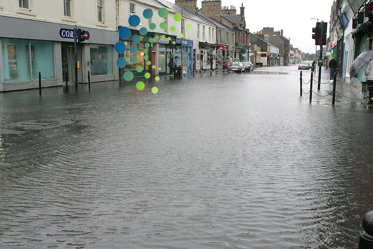 Troon's Portland Street is Flooded with water coming back up out of the drains.  A flooded Portland St. Picture: Universal News and Sport (Europe)17/10/2011