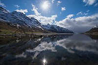 Spring snow mountain reflection in Skjelfjord, Flakstadøy, Lofoten Islands, Norway
