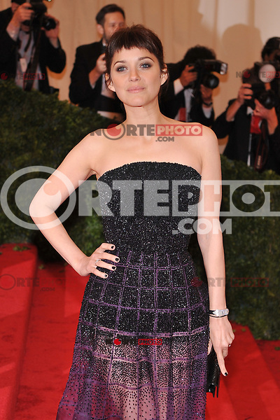 Marion Cotillard at the 'Schiaparelli And Prada: Impossible Conversations' Costume Institute Gala at the Metropolitan Museum of Art on May 7, 2012 in New York City. © mpi03/MediaPunch Inc.