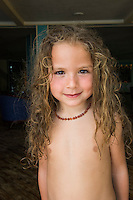 Honduras, Roatan Island, Fantasy Island Resort, Caribbean. Baby Maya (4), at the beach.