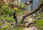 CHESHIRE, CT. 16 May 2018-051618BS89 - Dave Behlman of Hillview Property Maintenance of Naugatuck uses a chainsaw on a tree that tore through a garage during yesterday's strong storms on Sorghum Mill Drive in Cheshire on Wednesday afternoon. Bill Shettle Republican-American