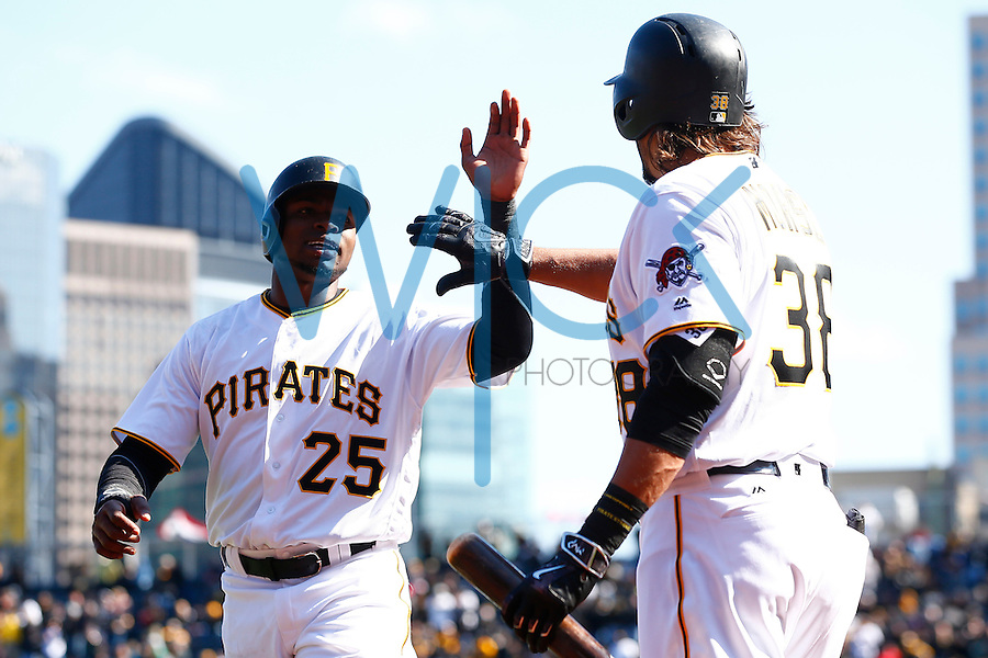 Gregory Polanco #25 of the Pittsburgh Pirates is congratulated by teammate Michael Morse #38 of the Pittsburgh Pirates after scoring on a double by Jordy Mercer #10 in the 8th inning against the St. Louis Cardinals during the Opening Day game at PNC Park in Pittsburgh, Pennsylvania on April 3, 2016. (Photo by Jared Wickerham / DKPS)