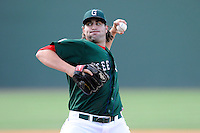 Relief pitcher Mike Adams (33) of the Greenville Drive delivers a pitch in a game against the Savannah Sand Gnats on Sunday, June 22, 2014, at Fluor Field at the West End in Greenville, South Carolina. Greenville won, 7-3. (Tom Priddy/Four Seam Images)