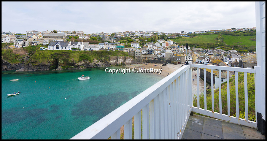 BNPS.co.uk (01202 558833)<br /> Pic: JohnBray/BNPS<br /> <br /> Stunning views back to Port Isaac.<br /> <br /> Fancy Martin Clunes as your next door neighbour?<br /> <br /> A striking Cornish hillside home with views out to the Atlantic and just 30 yards from the main filming location for Doc Martin is on the market for £950,000.<br /> <br /> Northcliffe in the village of Port Isaac is the next house up the hill from Fern Cottage, which doubles as Martin Clunes' grumpy character's GP surgery.<br /> <br /> The picturesque property can regularly be seen in the background of the ITV comedy drama, which is currently filming its eighth series in the fishing village, when Doc Martin leaves his surgery.