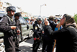 A Palestinian woman scuffle with Israeli police, after arresting a Palestinian during clashes between Palestinian youth and the Israeli police in the east Jerusalem neighbourhood of Silwan on May 12, 2012. Israel is to reply on May 12, to a letter from Mahmud Abbas voicing the Palestinian president's grievances over the failed peace process, a senior Palestinian official said. Photo by Mahfouz Abu Turk