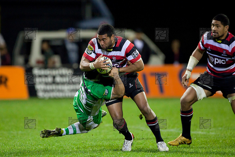 Shannon Paku swings off Siale Piutau as he tries to stop his run. ITM Cup rugby game between Counties Manukau and Manawatu played at Bayer Growers Stadium on Saturday August 21st 2010..Counties Manukau won 35 - 14 after leading 14 - 7 at halftime.