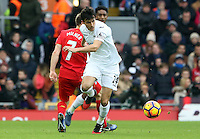 Jack Cork (Vice-captain) of Swansea City wins possession from James Milner (vice-captain) of Liverpool during the Premier League match between Liverpool and Swansea City at Anfield, Liverpool, Merseyside, England, UK. Saturday 21 January 2017