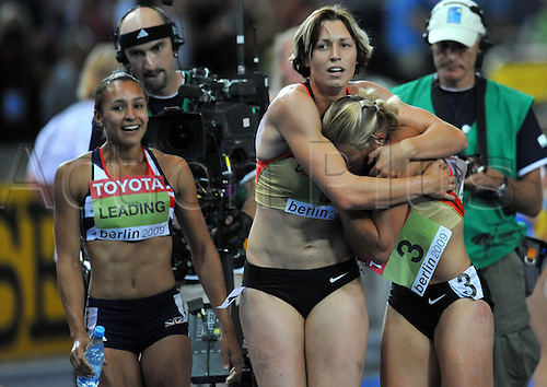 Jennifer Oeser of Germany (R) celebrates with team mate Julia Maechtig (C) after placed second in the Heptathlon event at the 12th IAAF World Championships in Athletics, Berlin, Germany, 16 August 2009. Left is winner Jessica Ennis of Great Britain. Photo: BERND THISSEN/ActionPlus. UK Licenses Only