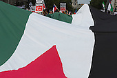 London, UK. 26 July 2014. A giant Palestinian flag arrives in Parliament Square.  Protesters gather in Parliament Square and Whitehall after a march from the Israeli Embassy in Kensington to call for an end to the Israeli military action against the Palestinians in the Gaza Strip at a political rallye.