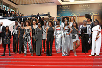 "Cannes Film Festival Director Thierry Fremaux and jury member Khadja Nin stand behind (L-R) Shirley Souagnon, Karidja Toure, Assa Sylla, Sonia Rolland, Magaajyia Silberfeld, Mata Gabin, Eye Haidara, Rachel Khan, Aissa Maiga and Nadege Beausson-Diagne authors of the book 'Noire n'est pas mon métier (Black is not my job)' at the ""Burning"" premiere during the 71st Cannes Film Festival at the Palais des Festivals on May 16, 2018 in Cannes, France. Credit: John Rasimus / Media Punch ***FRANCE, SWEDEN, NORWAY, DENARK, FINLAND, USA, CZECH REPUBLIC, SOUTH AMERICA ONLY***"