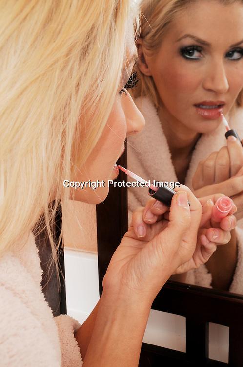 Woman putting cosemetics