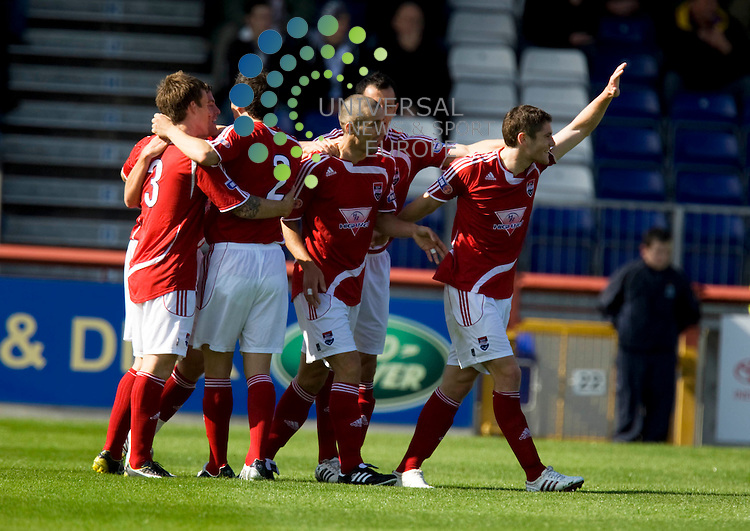 FOOTBALL.Irn Bru league Div 1.Inverness CT v Ross County. Ross Co players celebrate with Paul Di Giacomo(centre)after opening the scoring