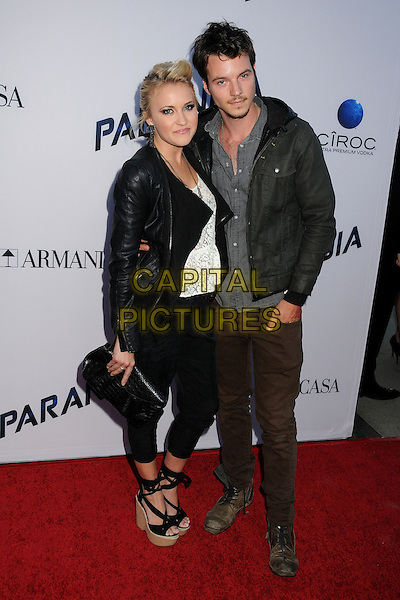 Emily Osment, Nathan Keyes<br /> &quot;Paranoia&quot; Los Angeles Premiere held at the Directors Guild of America, West Hollywood, California, USA, 8th August 2013.<br /> full length black trousers jacket white top clutch bag ankle strap wedges leather <br /> CAP/ADM/BP<br /> &copy;Byron Purvis/AdMedia/Capital Pictures