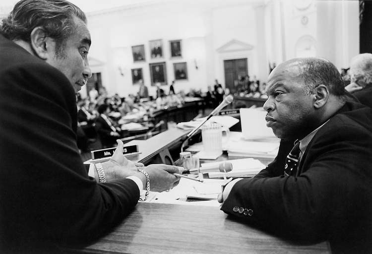 """Rep. Charles Bernard """"Charlie"""" Rangel, D- N.Y., and Rep. John Robert Lewis, D- Ga., in conversation in the Ways and Means Committee room.  They are discussing Medicare. October 10, 1993 (Photo by CQ Roll Call)"""