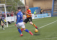 Jordan Marshall cuts the ball back behind Steven Anderson in the SPFL Ladbrokes Championship football match between Queen of the South and Partick Thistle at Palmerston Park, Dumfries on  4.5.19.