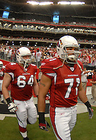 Aug 18, 2007; Glendale, AZ, USA; Arizona Cardinals defensive end Joe Tafoya (71) and center Scott Peters (64) against the Houston Texans at University of Phoenix Stadium. Mandatory Credit: Mark J. Rebilas-US PRESSWIRE Copyright © 2007 Mark J. Rebilas