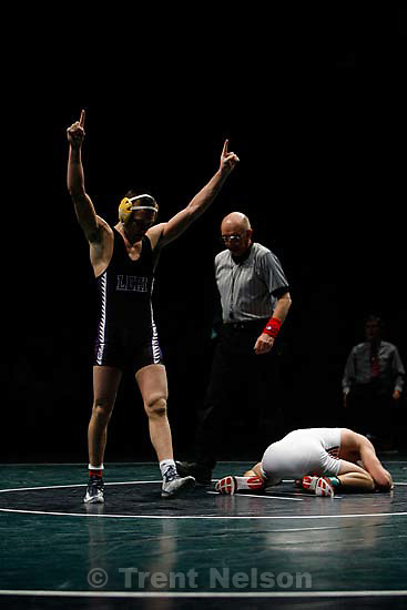 Orem - Lehi's Cam Phillips celebrates victory over Rodney Cox (Spanish Fork) in the 135 lb weight class, 5A State High School Wrestling Championships, held at UVSC, Friday, February 15, 2008.