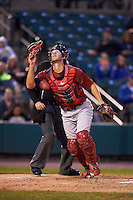 Lehigh Valley IronPigs catcher Logan Moore (11) looks for a foul ball pop up in front of umpire Chad Whitson during a game against the Rochester Red Wings on May 15, 2015 at Frontier Field in Rochester, New York.  Rochester defeated Lehigh Valley 5-4.  (Mike Janes/Four Seam Images)