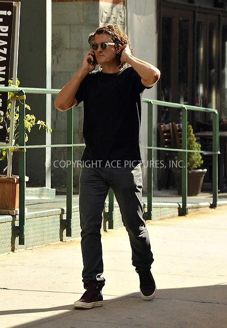 ACEPIXS.COM<br /> <br /> October 8 2014, New York City<br /> <br /> Actor Orlando Bloom walks in Tribeca on October 8 2014 in New York City<br /> <br /> By Line: Curtis Means/ACE Pictures<br /> <br /> ACE Pictures, Inc.<br /> www.acepixs.com<br /> Email: info@acepixs.com<br /> Tel: 646 769 0430