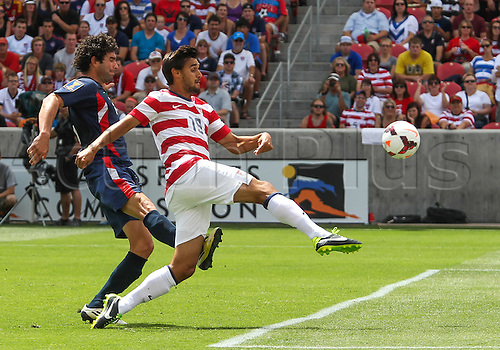 13.07.2013. Sandy, Utah, USA. US Men's National forward Chris Wondolowski (19) kicks the ball for a goal in front of Cuba defender Jorge Luis Clavelo (5) during the CONCACAF Gold Cup soccer match between USA Men's National team and Cuba at Rio Tinto Stadium in Sandy, UT. USA.