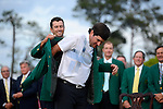 Adam Scott presents Bubba Watson with green jacket during the green jacket ceremony after the final round of the Masters Tournament at Augusta National Golf Club on Sunday, April 13, 2014, in Augusta, Ga