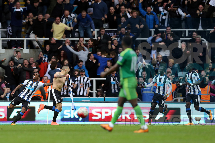 Newcastle United's Aleksandar Mitrovic, center, celebrates his goal during the Barclays Premier League match at St James' Park Stadium. Photo credit should read: Scott Heppell/Sportimage