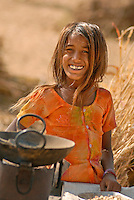 A young girl of the nomadic Raika caste at the Pushkar Camel Fair. Every year in late October or November, hundreds of thousands of India's nomadic tribes descend on the holy city of Pushkar.
