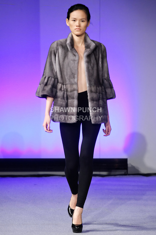 Tuyết Lan, Vietnam's Next Top Model 2010 poses in a fur coat from the Kostas Outerwear collection, by Kostas Gagasoules, during Couture Fashion Week New York, February 18, 2012.
