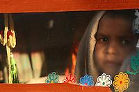 04.11.2008 Pushkar(Rajasthan)<br /> <br /> Child of pilgrims waking up after a night in a truck during the annual fair of Pushkar.<br /> <br /> Enfant de p&egrave;lerins se reveillant apres une nuit dans un camion pendant la foire annuelle de Pushkar.