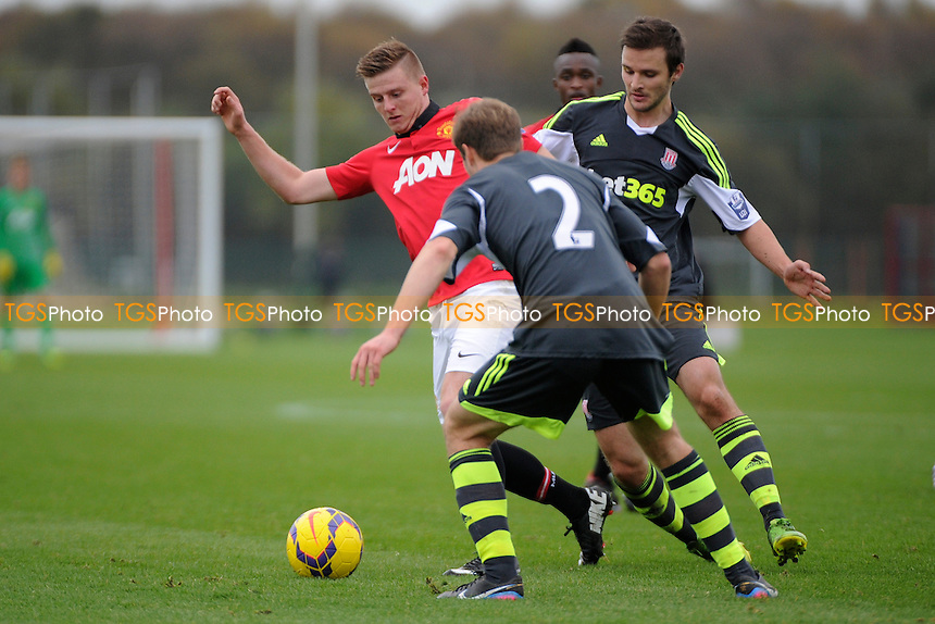 Jack Barmby of Manchester vies for the ball with Elliot Wheeler of Stoke City - Manchester United Under-21 vs Stoke City Under-21 - Barclays Under-21 Premier League Football at the Aon Training Complex - 08/11/13 - MANDATORY CREDIT: Greig Bertram/TGSPHOTO - Self billing applies where appropriate - 0845 094 6026 - contact@tgsphoto.co.uk - NO UNPAID USE